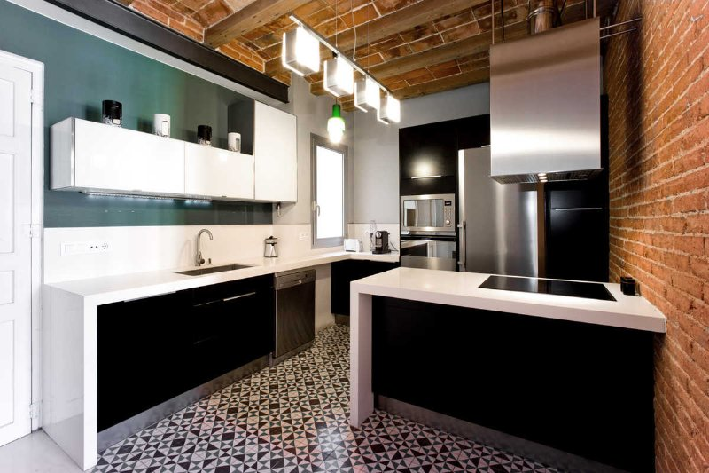 modern kitchen with antique tiles floor and wooden ceilings
