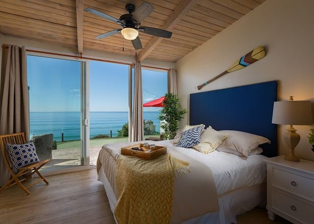 bedroom with king bed and ocean views