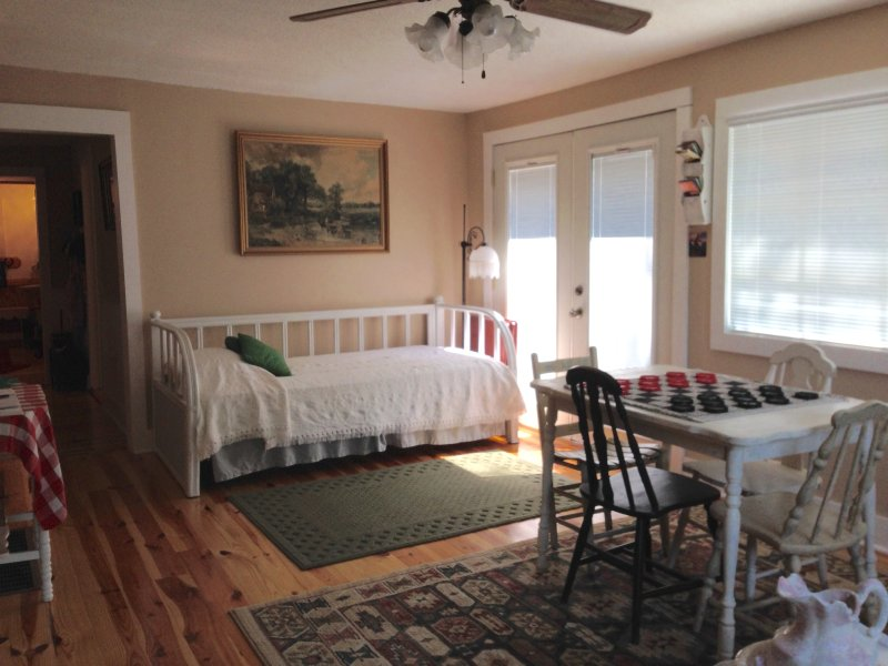 3 twin beds with a view of the field