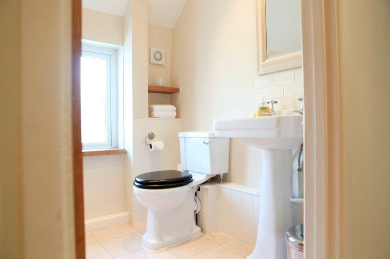 Lovely bright bathroom, with bath and shower