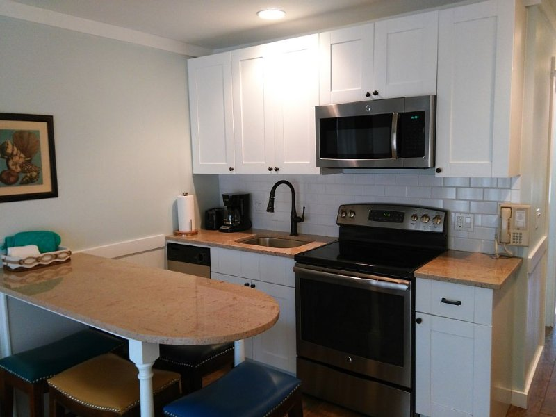 Our fully-equipped kitchen  - dishwasher, garbage disposal, smooth-top range . . . .