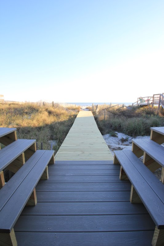 Step off the front porch and on to the boardwalk.