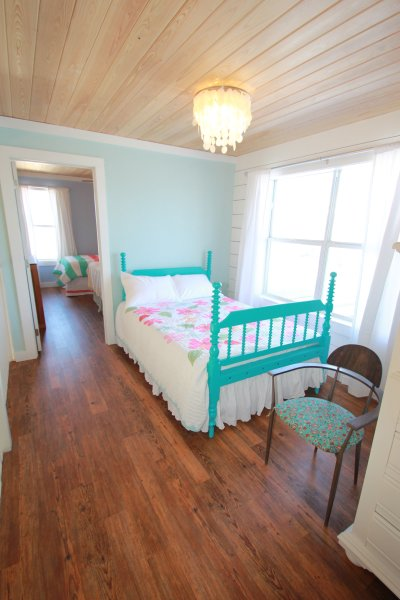 Loft with antique spindle bed and brand new memory foam mattress.