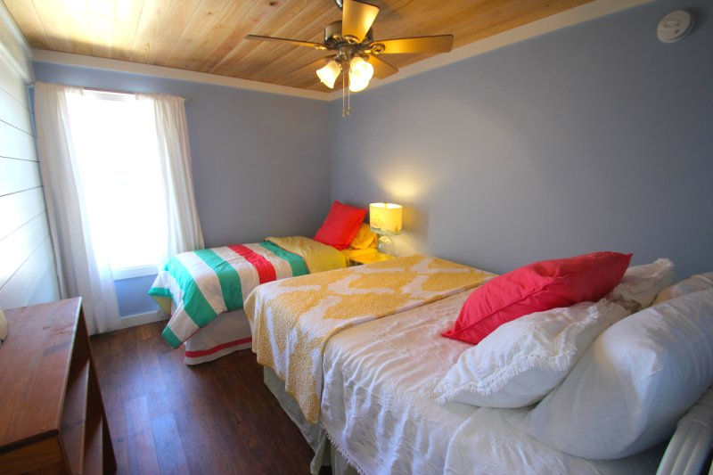 Upstairs bedroom with queen antique bed and twin bed and great gulf views!