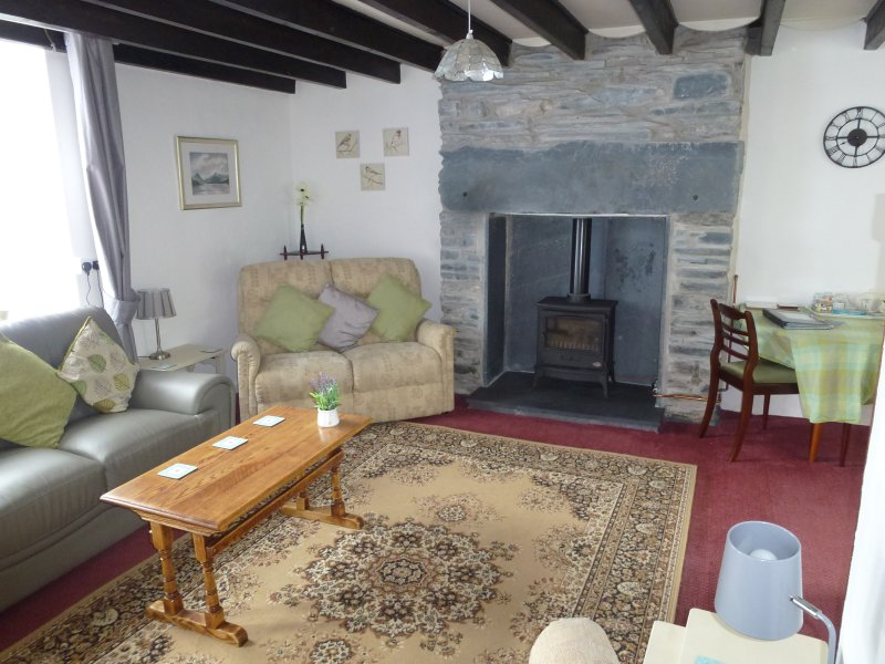 Living Room with 2 comfy sofas and 1 comfy armchair - great to relax in after a busy day out
