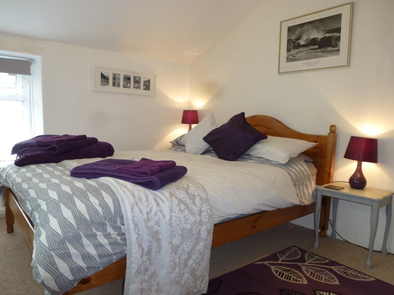 Double bedroom - double aspect and built in ceiling to floor large wardrobe for storage. Hairdryer.