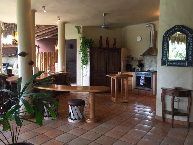 Open-air kitchen with breakfast bar