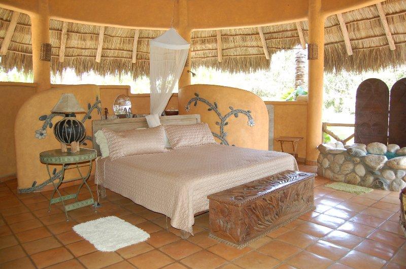 Open-air, en-suite king bedroom