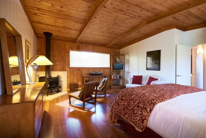 Master bedroom has it's own fireplace and seating area.