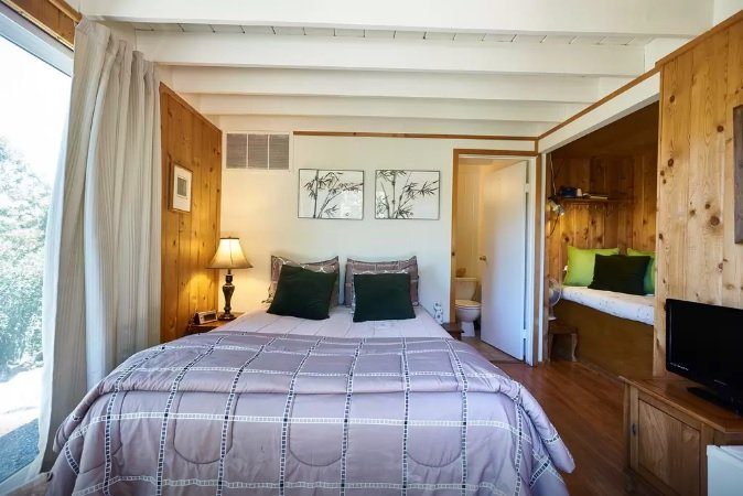 Detached bedroom with a queen sized bed and one twin.