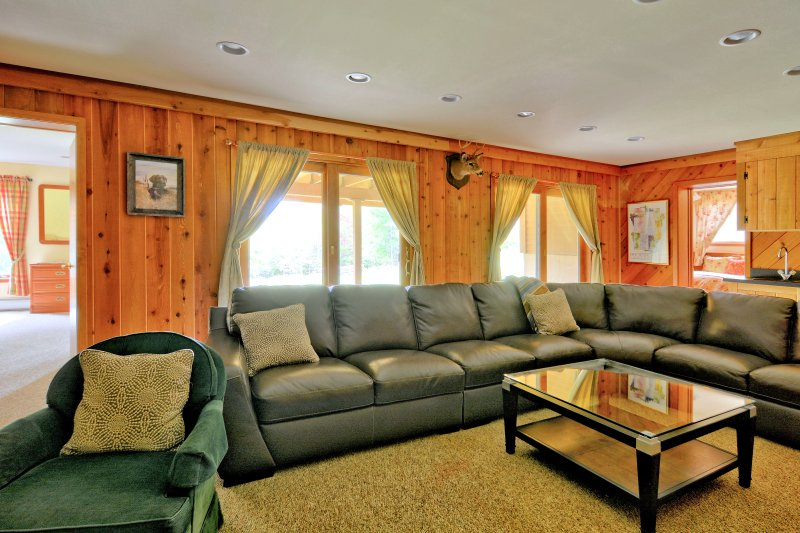 Den Featuring Large Wood Burning Fireplace, 60' 4KHD TV, & Wet bar