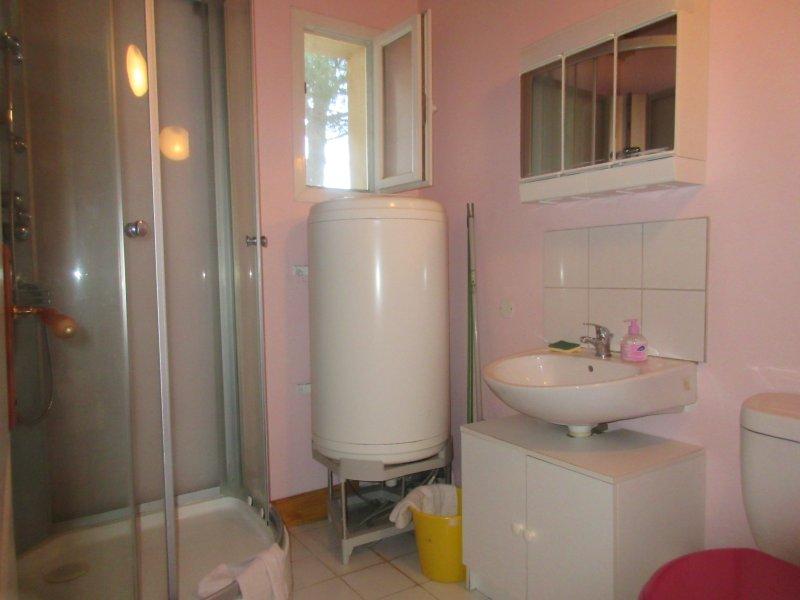 The bathroom cabin shower toilet sink