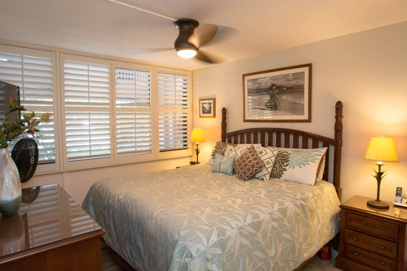 King bed, plantation shutters for air flow and privacy control. Full-size futon stored under bed