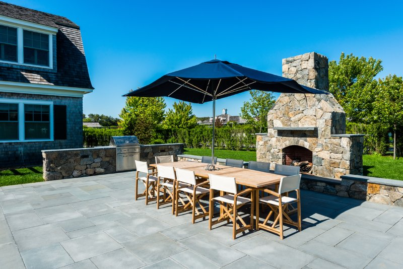 Outdoor Dining and Field Stone Fire Place