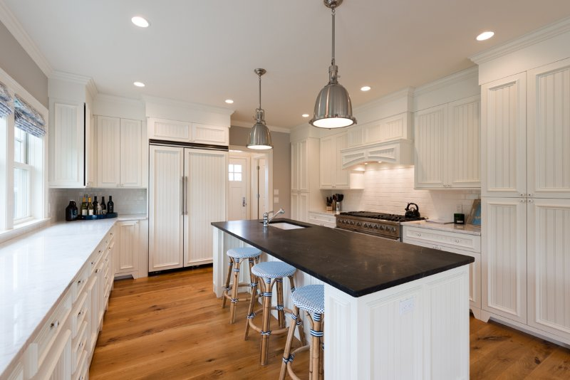 Chef's Kitchen with Center Island, Breakfast Bar and Professional Appliances