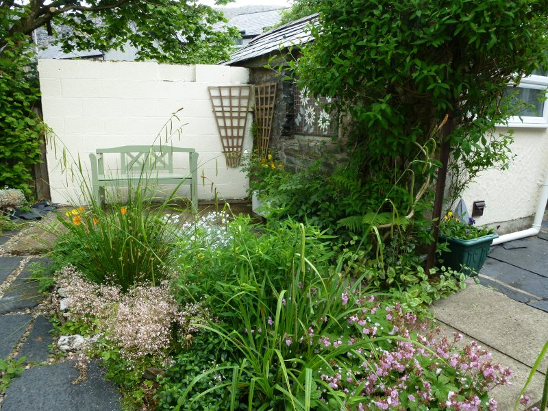 Cottage garden with outhouse (Boot/Drying room; outside loo). 2 additional foldup chairs available