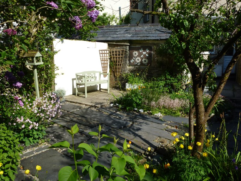 Private, enclosed slated garden