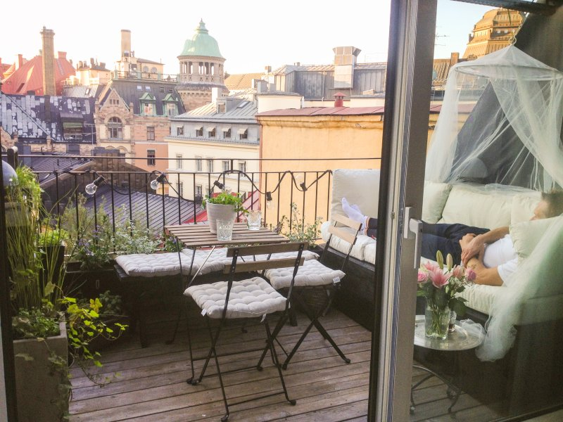 Terraço com uma vista mágica sobre os telhados em Estocolmo