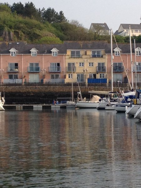 Yellow townhouse recently refurbished with fabulous views over marina