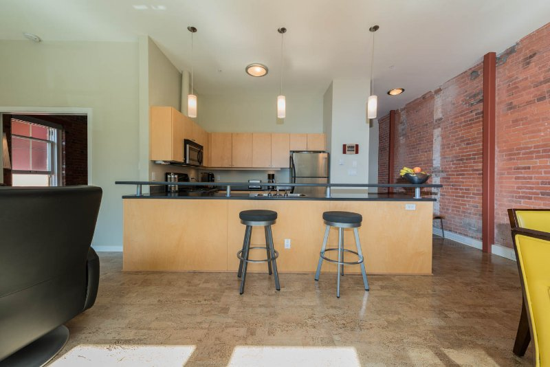 Two Counter Stools Along A Generous Counter top
