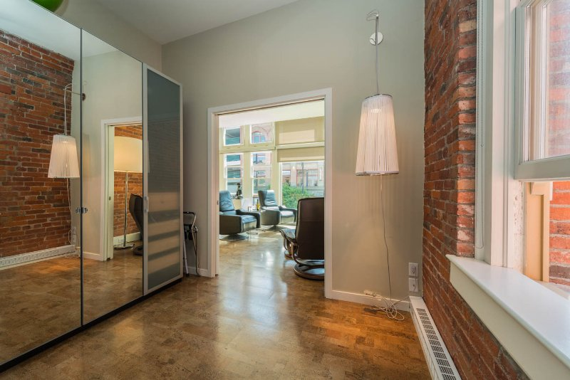 Large Mirrored Closet On Left In Bedroom