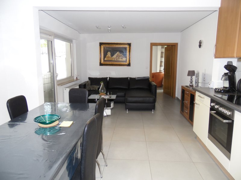 Living and dining area, here you can relax, watch television, cook and eat