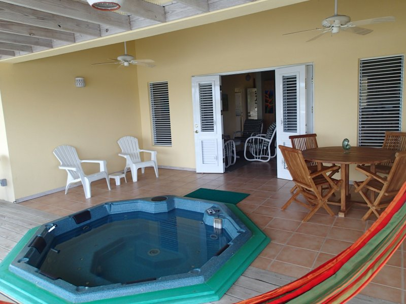 Enjoy the Jacuzzi on the verandah.  View to the waterway and the sunset.