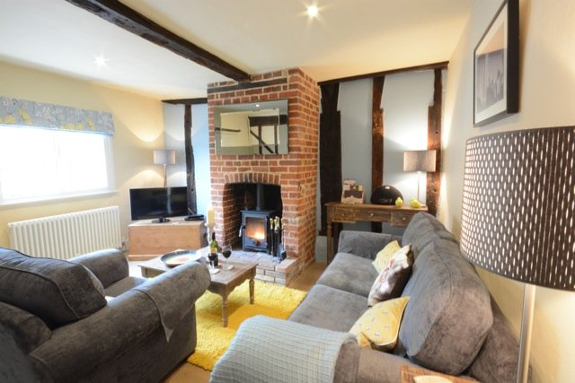 Sitting Room - Relax in front of wood burner with a glass of wine