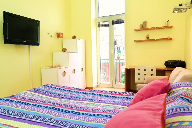 main bedroom with balcony