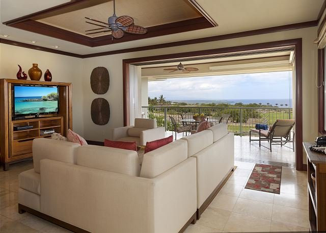Living room with large sliding doors to open up for the ocean br