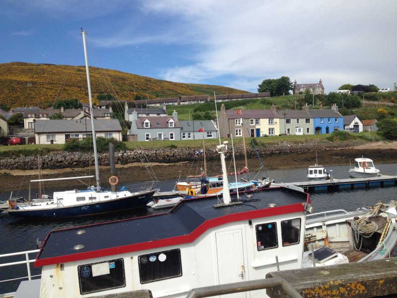 The harbour with the blue/grey Hoose in the centre