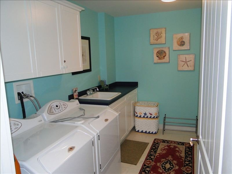 Full sized laundry room with plenty of room to wash and dry clothes