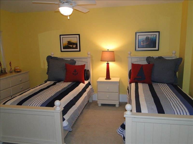 Roomy third bedroom with large closets and flat screen TV