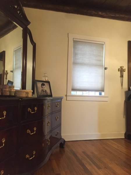 Dresser in master bedroom provides lots of room for clothes