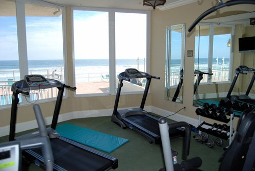 Gym overlooking the pool and ocean