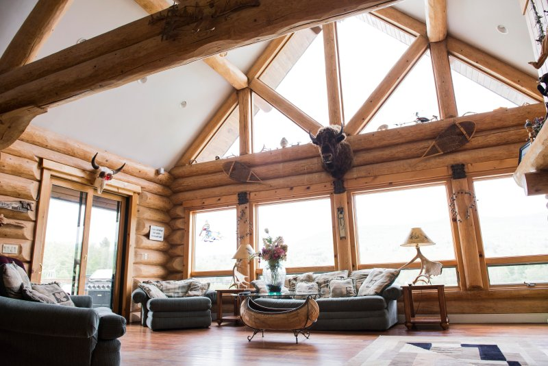 soaring ceilings massive logs, beautiful mountain and lake views