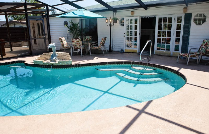 Pool side looking into patio and French doors