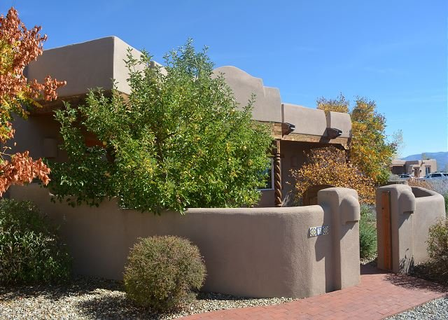 Approach to enclosed front entry and the sweetest golden delicious apple tree in all of Taos - for lucky 'autumn guest's' enjoyment