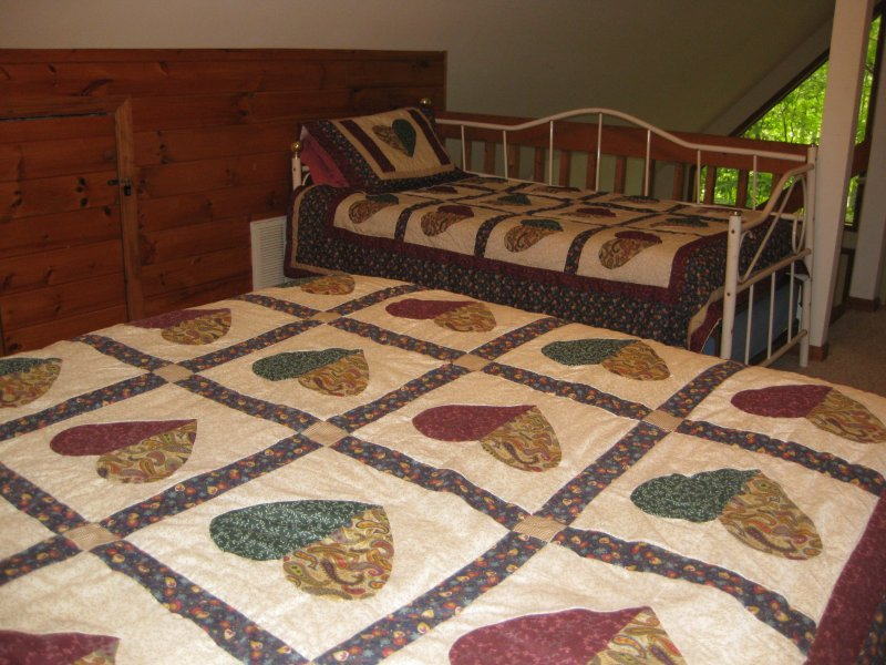 Loft bedroom has a queen-size bed and a daybed with a pop-up trundle.