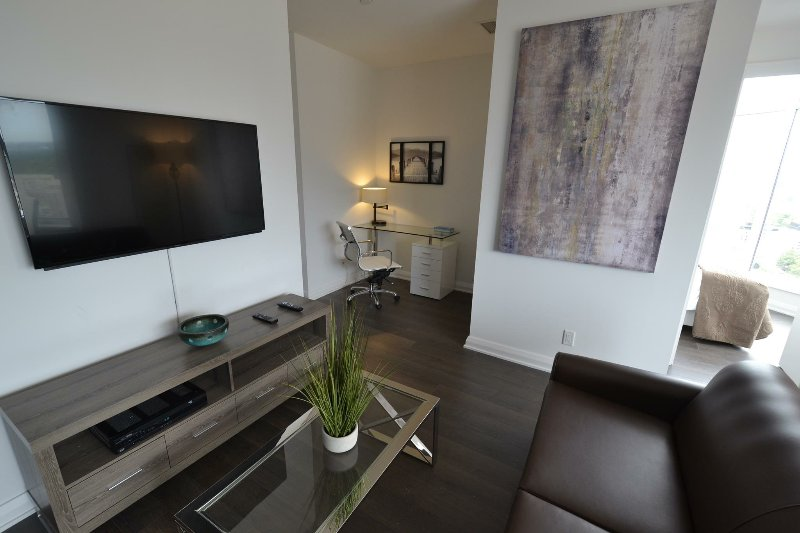 Designer decorated Living / Dining room with a double sofa bed & Plazma LCD TV. Free WiFi and Cable!