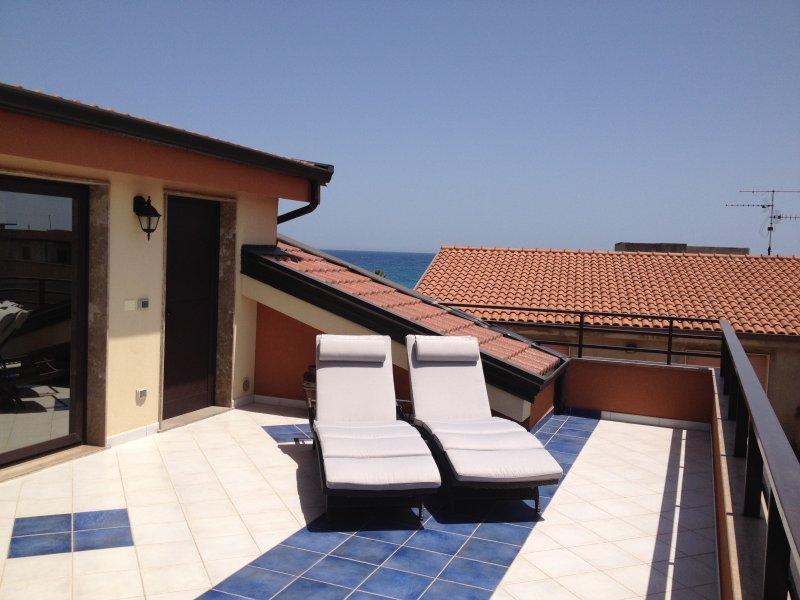 Terrasse avec vue sur l'océan