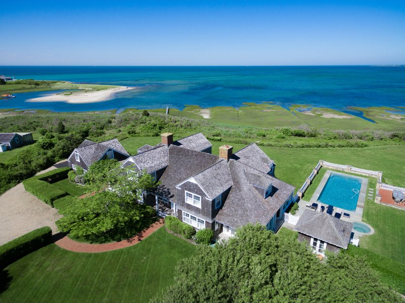 Aerial View of Gorgeous Estate Waterfront Home with Heated  Pool