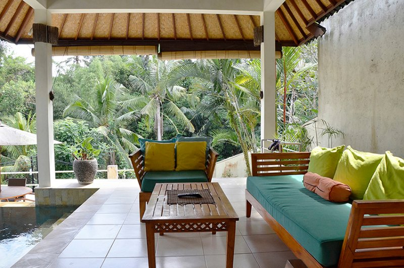 The living room is open to views, the pool and dining area.