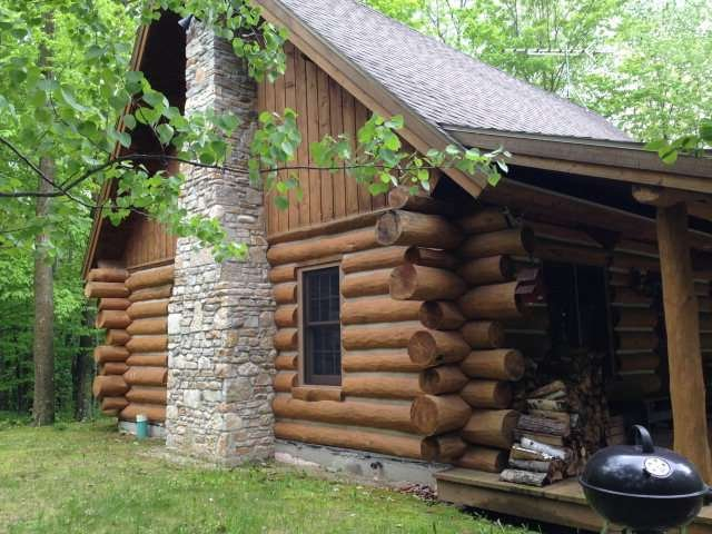 Beautiful log cabin on quiet wooded 1.5 acre lot.