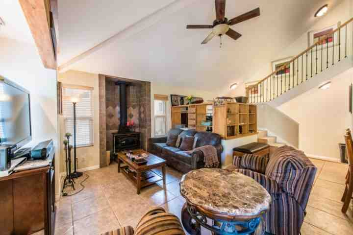 Great room with large screen HDTV, wood burning stove, queen sleeper sofa with Serta-quality air mattress.