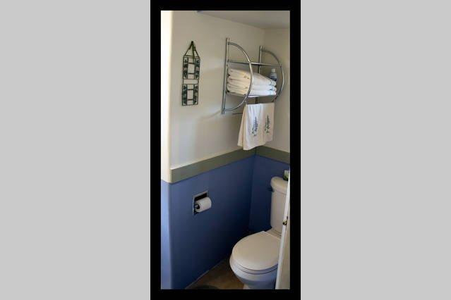 General bathroom detail, shower around the corner.
