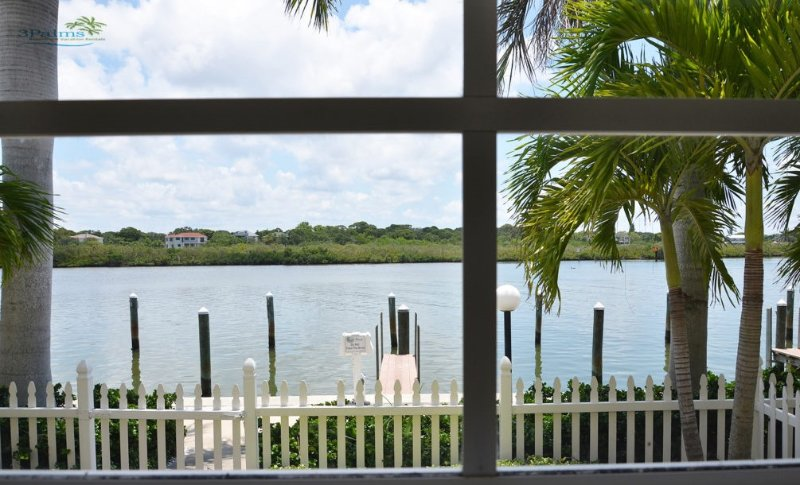 Water View of the Wonderful Intercoastal from your sunroom and private patio!