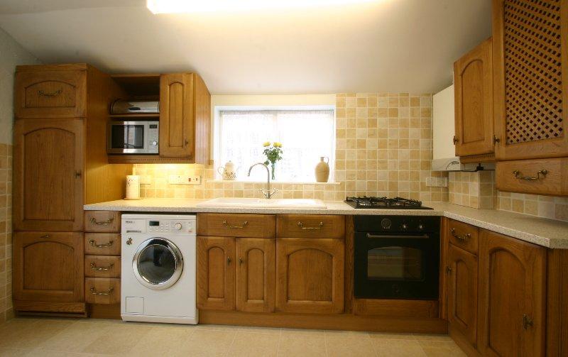 Badgers Den Kitchen complete with oven, hob, microwave, fridge/freezer washer/dryer.