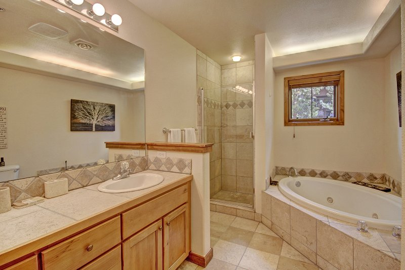Master Suite Bathroom. Jetted Tub, Shower, His & Hers basins