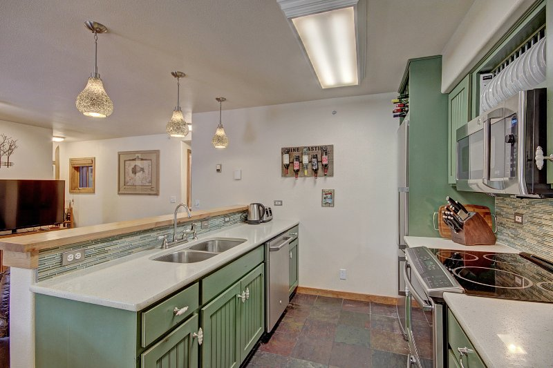 Well equipped European style kitchen, with granite tops